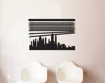 Layered City Skyline Silhouette With City Lights Wall