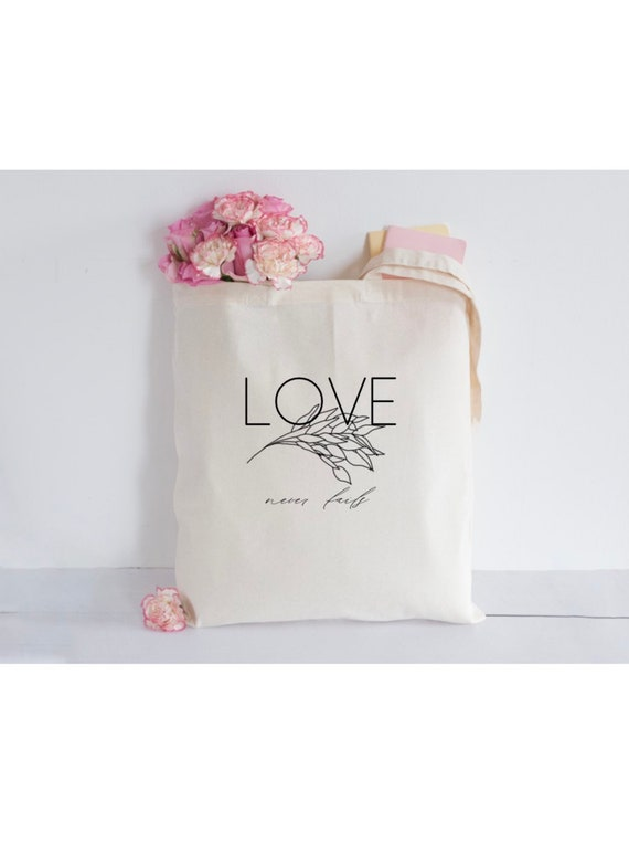 Love Never Fails Canvas Tote
