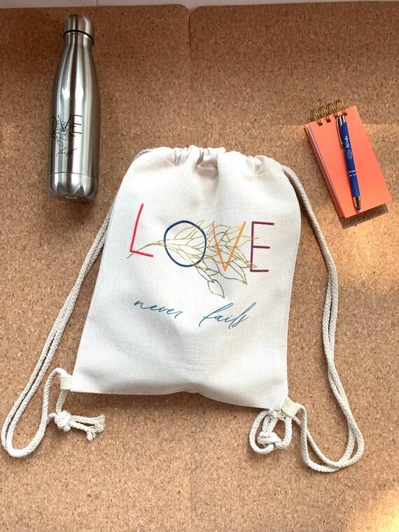 Love Never Fails Drawstring Linen Canvas Tote