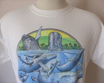 560c3751 aloha Whale Watch Hawaii vintage 90's Captain Dan McSweeney white graphic t- shirt travel souvenir blue neon green whale dolphin seal logo