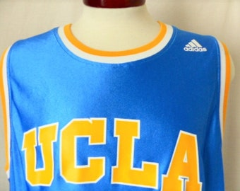 e98a2d418 Go UCLA Bruins vintage 90s University of California Los Angeles shiny blue basketball  jersey tank top muscle tee yellow white striped collar