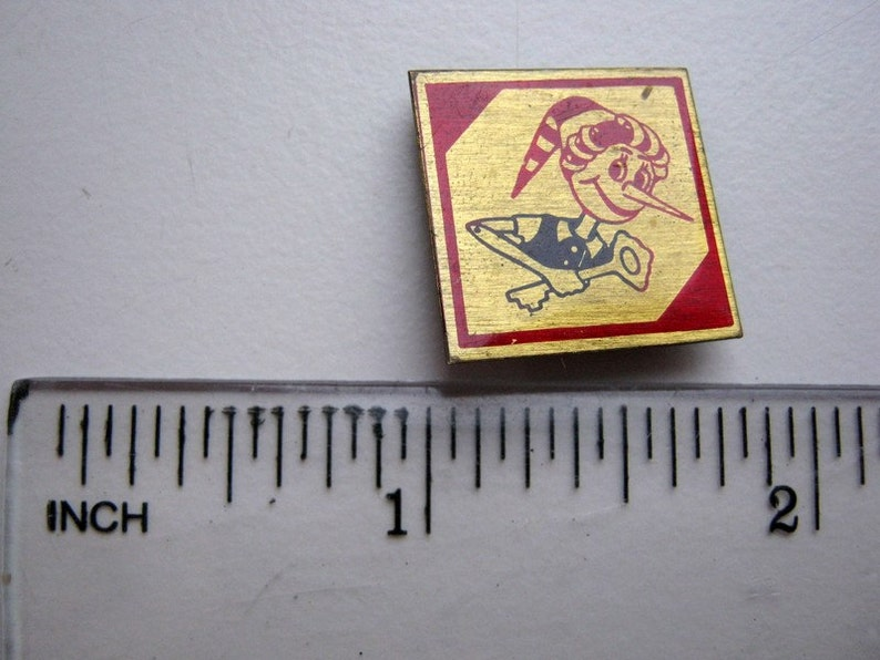 Small vintage soviet pin badge Buratino Pinocchio in acceptable condition