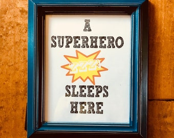 A Superhero Sleeps Here/ digital print