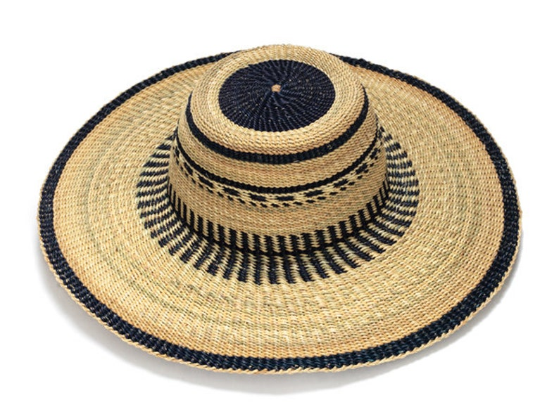 52384f2ed8c97 Hand crafted ethnic straw hat made in Gana Africa Wide brim
