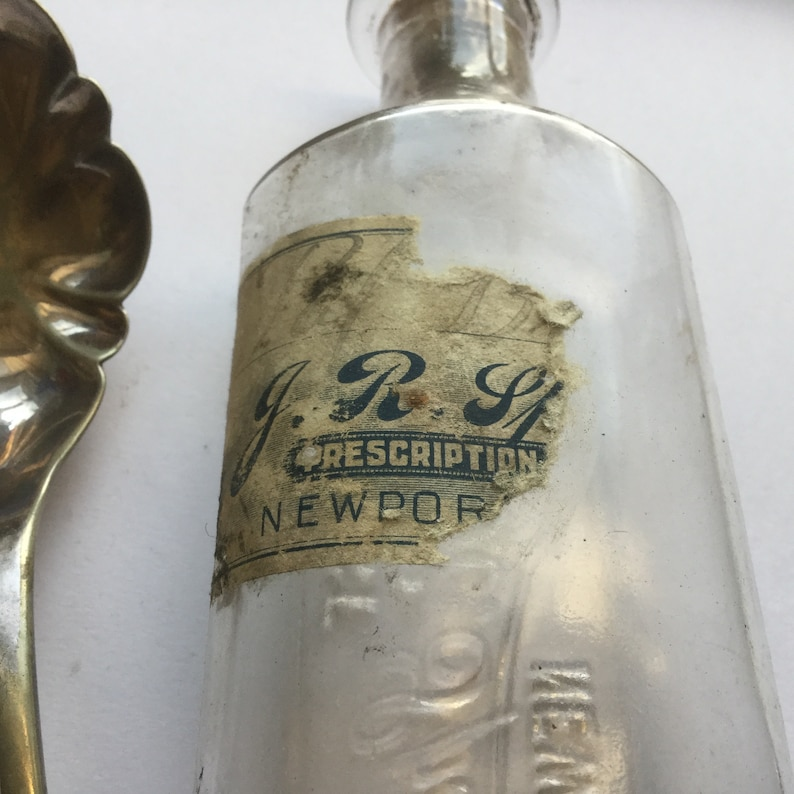 Druggist Bottle from J R Spencer of Newport ME Embossed Glass