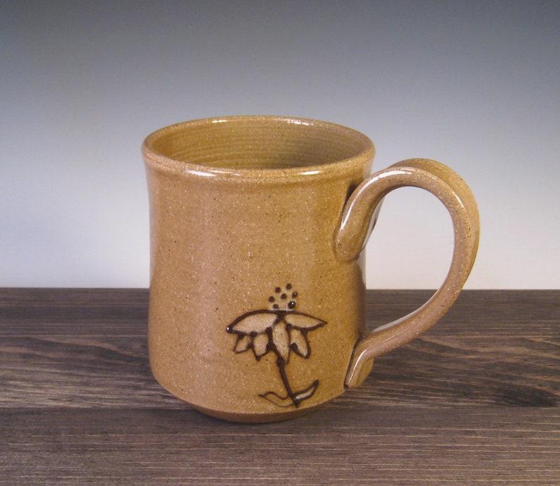 Mug  speckled brown with black slip echinacea design and image 0