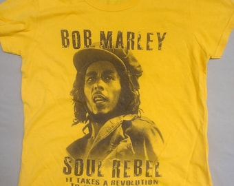 cc1a8999d Bob Marley T-Shirt. Soul Rebel On Gold Tee. Available In Men's and Ladies  Fitted Tee.