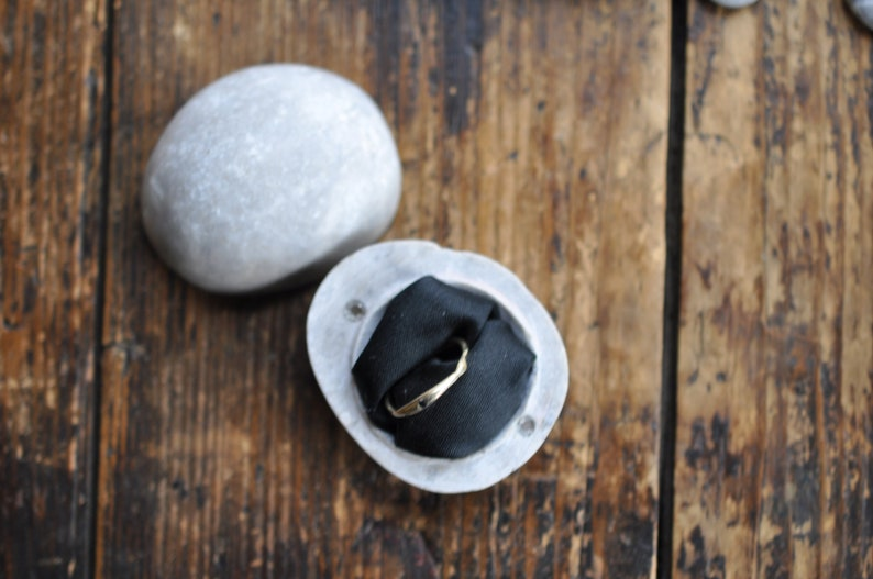 beige stony ring box for engagement ring penguin stone
