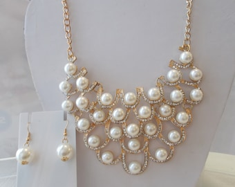 White Pearl Bib Necklace With Clear Rhinestones On Gold Tone Frames pn a Gold Chain with Matchind Earrings