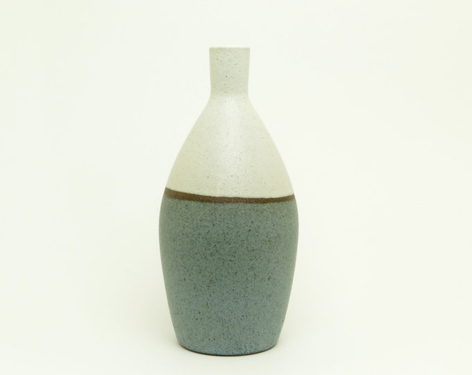 handcrafted stoneware vase, wheel thrown vase made with dark stoneware clay, rustic modern pottery vase, matte blue and satin white glaze.