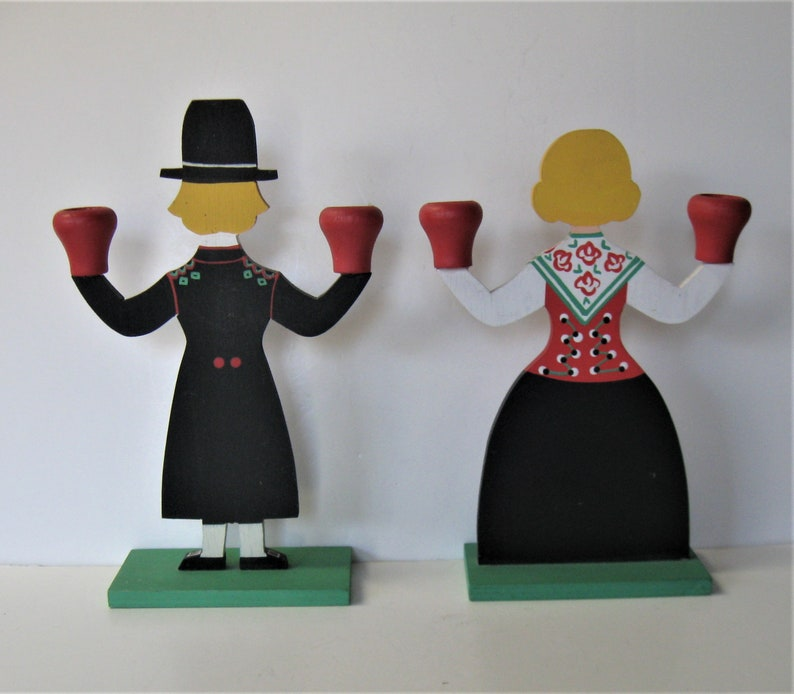 Hemslojden Boras 10 12 tall Pair of Swedish hand painted wooden candlestick holders Folk Art Bavarian man and woman figures gift