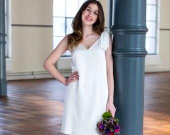Short, sexy mini wedding dress with deep v-neckline
