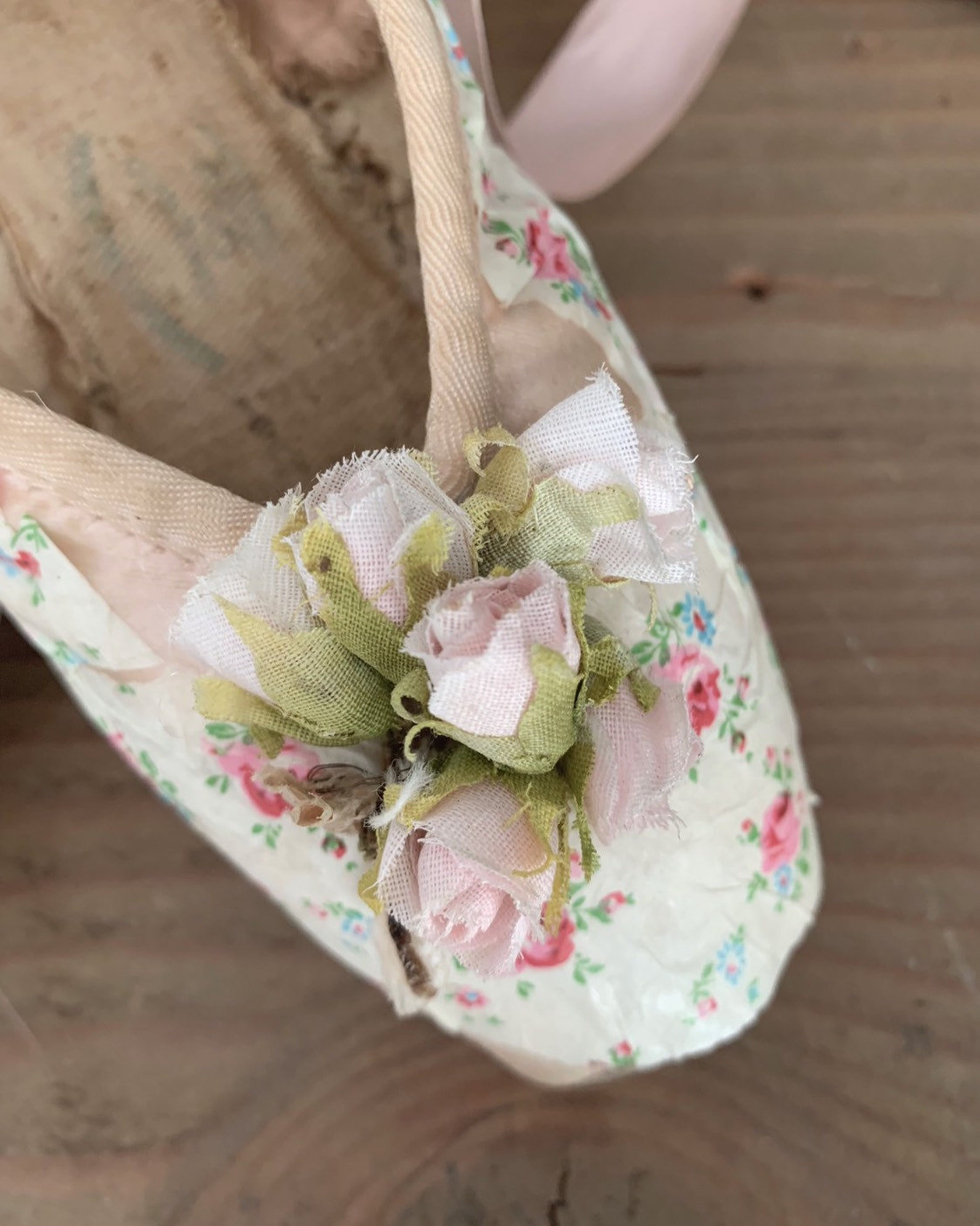 custom vintage well worn pink ballet ballerina slippers pointe shoes embellished with antique french fabric millinery roses dits
