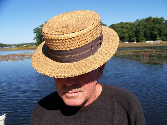 This is an antique Men's Straw Boater Hat.J.C.Penn