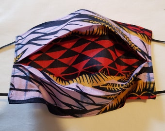 Pink red batik from Africa.  Inverted box pleat style.  two layer with space for filter.  One size fits both Men and women.