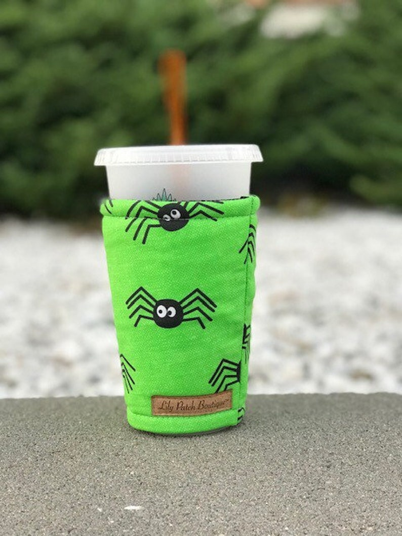 Halloween Spiders on Green Coffee Cozy Iced Coffee Cozy Cup image 0
