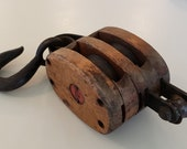 Antique Double Wooden Hook and Rope Barn Pulley Made From Cast Iron And Hard Wood With A Cast Iron Wheel