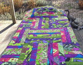 African Patchwork quilt with African prints from Ghana. Full size for Twin or throw on sofa.