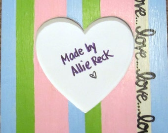 Painted Wooden Frame with blue, green, and pink stripes, and love