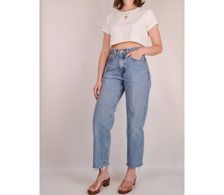 022d451b Vintage LEVI'S 560 Cut Off Jeans (28