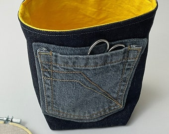 Denim bucket bag with pocket for knitting, embroidery or crochet. Reversible with a jeans pocket for storage.