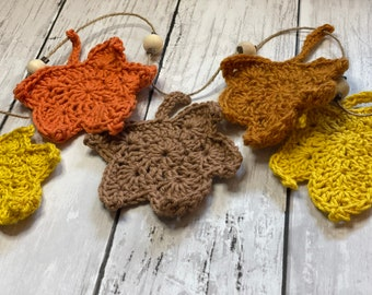 Garland of crocheted autumn leaves, hung with wooden beads and twine