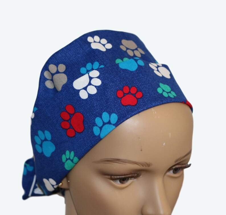 Colorful Paws on Royal Blue Pixie Tie-back Scrub hat Surgical image 0
