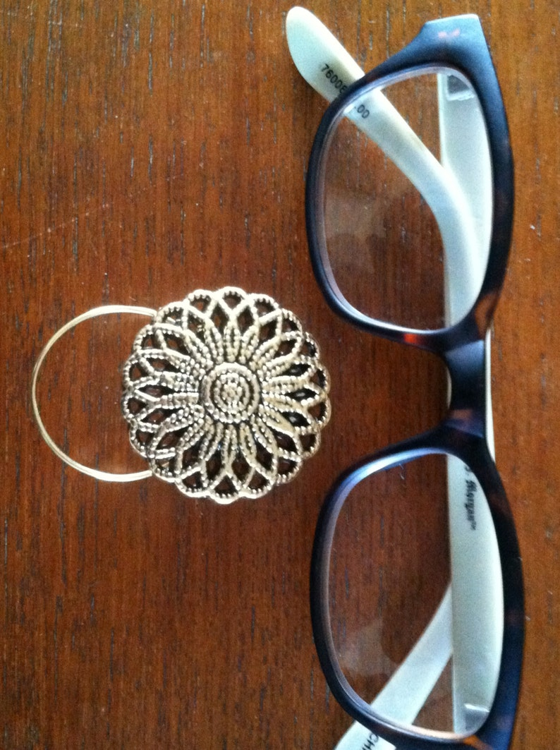 The mattie gold tone flower magnetic eyeglass holder is a image 0