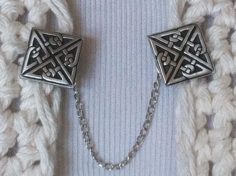 The mattie pewter Celtic square sweater clip adds a touch of interest to your cover ups.