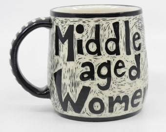 """Wheel thrown, hand carved porcelain """"Middle aged Women are Beautiful"""" mug by Karen James"""