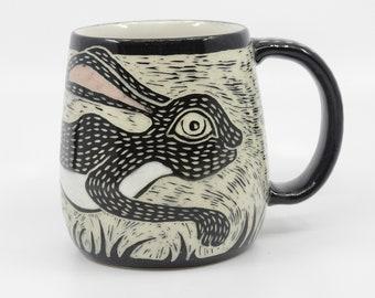 Wheel thrown, hand carved stoneware Rabbit mug by Karen James