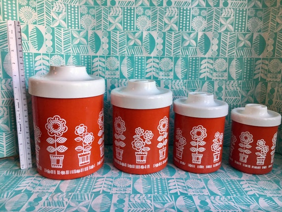 Vintage red and white Mod flower super cute kitchen canisters containers.  Will be perfect decor for your retro or mid century kitchen counte