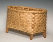 Hand woven footed basket