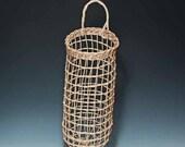 Hand woven potato basket