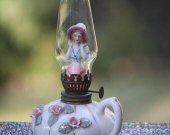 Lady in a kerosene lamp