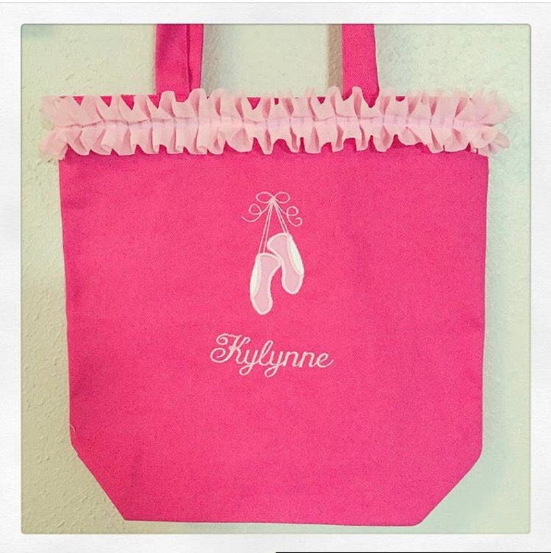 Pink ballet bag with embroidered applique of ballet slippers and name embroidered below slippers