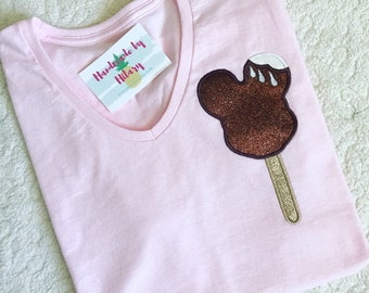 Millenial pink shirt or onesie with glittery mickey ice cream bar on left chest