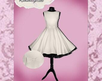 Knee-length wedding dress in 50s style cream