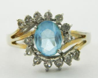 Faux Sky Blue Topaz Halo Ring