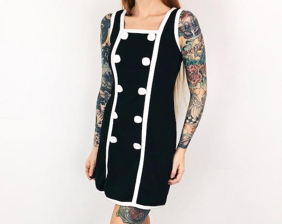 Mod Body Con Button Front Sleeveless Mini Dress