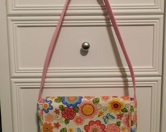 3aa0f40d099 Young Girls Messenger Bag Made With Multi Colored Floral Fabric