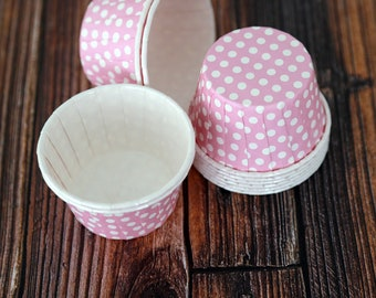 12 pink paper cups with polka dots