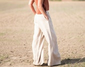Wide leg linen trousers in a beige color/OFFON CLOTHING