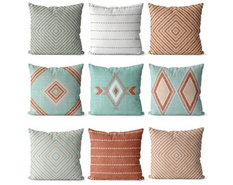 Southwest pillow covers with terracotta tan and  light aqua blue decor,  southwest pattens, earthtones rust orange, clay rustic decor