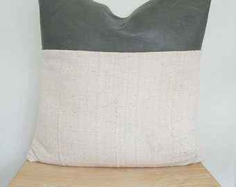 leather and mudcloth pillow cover