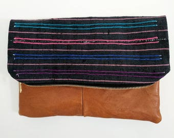 african mudcloth and leather fold over clutch