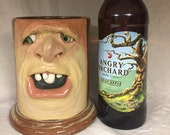 LARGE STEIN - wheel thrown, hand altered and sculpted. Just a friendly face to enjoy your favorite beverages with. Has a blemish.