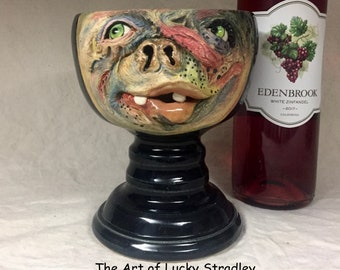 CHALICE, wheel thrown, hand altered and sculpted. Just a friendly face to enjoy your favorite beverages with.