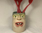 UTENSIL HOLDER - Wheel thrown, hand altered and sculpted ceramic vessel can also be used as vase, flower pot, tumbler, planter.