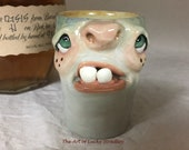 SHOT GLASS - wheel thrown, hand altered and sculpted. A friendly face to enjoy your favorite beverage. Holds 4 oz of your favorite beverage.